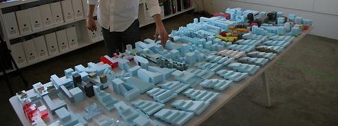 Hand adjusting architectural model in design office