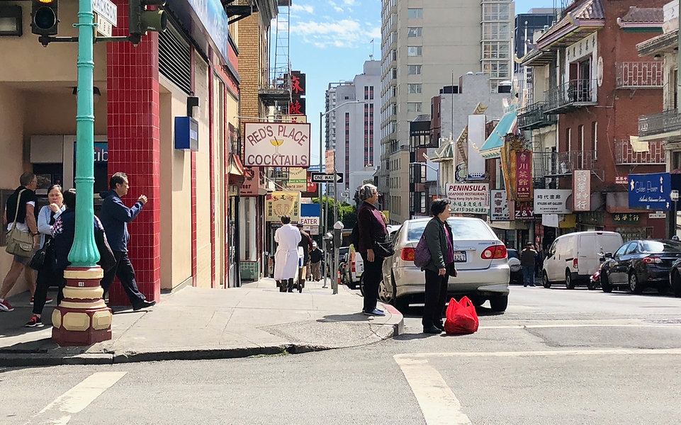 People crossing the street at the intersection of Grant and Jackson in Chinatown, San Francisco.