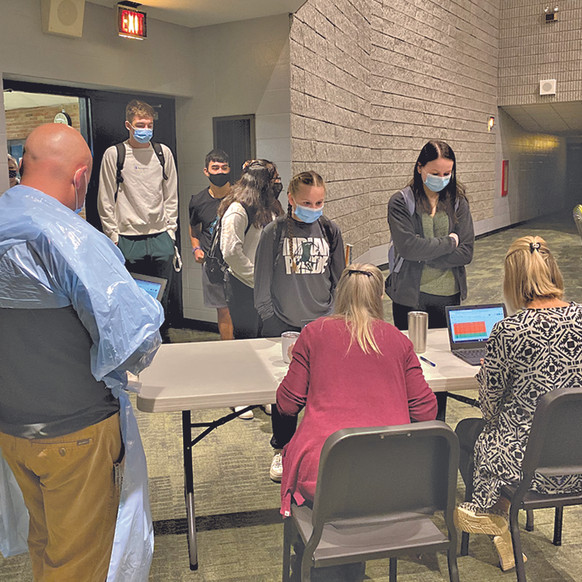"""Whitmer urges """"Get the Shot""""; Student athletes test for COVID weekly"""