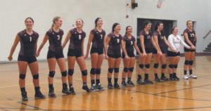 "TEAM LEADS GYM CROWD IN NATIONAL ANTHEM… When the public address system failed in the Watervliet High School Gym for a volleyball game September 20 the Panther team started singing the National Anthem and was soon joined by the opposing team and the audience. Pictured are WHS Panthers (from the left) Logan Mizwicki, Katie Schultz, Zoe Smith, Kara Liles, Mercede Daugherty, Maggie Lynch, Ma-dalyn Hutchins, Katie Clark, Grace Smith and Ariana Rowe. On the day of this game, reno-vation work in the gym was near completion and all the team banners and the American Flag were not yet back on the walls. As it was, the American Flag was at center court, held by coaches when the PA mal-functioned. After a few mo-ments, the WHS Girls Volley-ball Team began singing the anthem and was soon followed by their opponents, the Sauga-tuck Girls Volleyball Team and then the entire gymnasium. A video of the spontaneous demonstration of team spirit and pride quickly appeared on Facebook and soon went viral. The video was picked up by the TV news feature ""Inside Edi-tion"" and aired earlier this week. (Photo by Gloria Reeves)"
