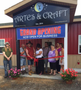 """RECENT RIBBON CUTTING… for Artes and Craft located in Hartford Town-ship. Friends and Cornerstone Women's Business Center were on hand to wish owners Pat Rose and Paul Barbary well on their new business. Artes and Craft officially opened on July 1, 2016 and features multi-cultural clothing, homemade soaps and incenses, unique je-welry, herbs, spices and candles. This entrepreneurial team opened the store to offer a place for their customers to shop, worship and celebrate. """"We wanted a venue to celebrate and respect the diversity of reli-gions,"""" said Barbary."""