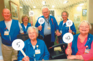 YOU ARE INVITED…to the Lakeland Hospital, Watervliet Auxiliary Quarter Auction fun-draiser coming up on Thursday, August 25 to benefit Lakeland Hospital, Watervliet. Promoting the event, these Watervliet Aux-iliary members (from the left) standing are Joe Engel, Linda Piehl, George Wood and Annie Elston; seated are Katie Davis and Kay Brown.