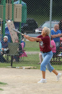 TOO HIGH BUT SHE HITS IT… Candy Evett hits the ball during first inning action Satur-day as the Hooterville Hitters faced the House of David Echoes in a vintage baseball game. The Echoes outpaced the Hitters, 20-13. (TCR photo by Kristy Noack)