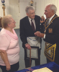 FRED HONORED...Fred Munchow, center, was honored for his 70 years as a Mason. As Fred's wife Edith looks on, Grand Master Bill Finnkel recognizes him for the rare achievement
