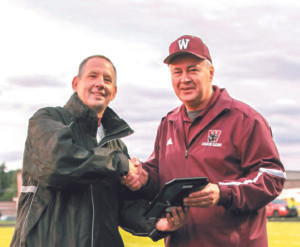 """21 YEAR VETERAN OF WATERVLIET CHAIN GANG HONORED… Watervliet High School Athletic Director Ken Dietz honored Art Frank prior to Friday's football game for Frank's 21 years of service as part of the Panther """"Chain Gang."""" Frank was presented with a plaque that thanked him for his professionalism and loyalty."""