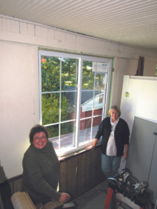 VAN BUREN COUNTY MUSEUM… replaced eight windows in the museum's Sun Room this week, thanks in part to a $5,500 donation from 100 + Women Who Care, Van Buren. The work was done by Howe Patio and Windows, Plainwell. The museum is continuing its fundraising efforts to replace windows in the historic building. Shown in photo are (from the left) museum volunteer, Kris Brando and museum President, Sandra Merchant.