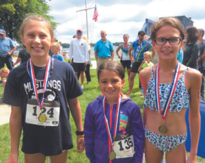LITTLE LADIES PLACE IN PAW PAW LAKE TRI….Pictured left to right are the winners of the girls' division of Saturday's Paw Paw Lake triathlon: Hayden Bos in first place, Alexis Hernandez in second place, and Jessica Coates in third place. (Contri-buted photo)