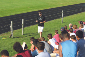 TIM HILLER SPEAKS AT WATERVLIET'S FALL SPORTS MEETING… Tim Hiller, former Western Michigan University and Indianapolis Colts quarterback, spoke to stu-dent athletes and parents at Wa-tervliet's fall sports meeting. Hiller spoke about the impor-tance of athletes setting goals, defining and playing a specific role within the team, and treat-ing the team as a whole. (TCR photo by Kristy Noack)