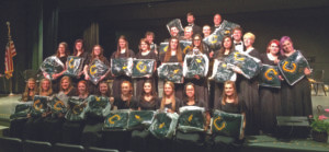 Coloma High School Band se-niors… were recently presented personalized blankets or framed certificates in honor of their years of participation in the Co-loma Band Program.  Pictured front row (from the left):  Courtney Kroschel, Carly Lentz, Ally Jarvis, Sydney Mil-ler, Emma Tavolacci, Jenna Miller, Ashley Sipla, Gabby Gordon, Katie Martinez, and Tori Kolenko.  Second row (from the left): Michelle Lester, Nicole Baldwin, Allison Marti-nez, Tessa Parrigin, Becka Plitt, Lexi Ludwig, Emily Moody, Alexis Kroschel, Sabrina Ball, Taylor Culby, and Chloe Poirier.  Third row (from the left):  Nate Tallman, Tyler Blevins, Eric Gorzynski, Reese Sample, and Alex Moore.  Fourth row (from the left):  Zack Swisher and Michael Pellerito.