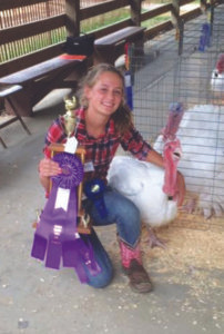 CELINA KLIMKIEWICZ… 15, is a sophomore attending Watervliet High School. She received a Champion trophy for her Tom Turkey and a Grand Champion Overall. She is the daughter of Jeff and Nicole Klimkiewicz. The whole family did well with their poultry: Skylar took 2nd, Casey took 3rd, Keyona took 6th, and Sa-brina took 7th. It was Sunny-brooke Farms in Berrien Springs that purchased all five of the turkeys. The grand champion market turkey sold for $250. It was noted that Sunnybrooke purchased multiple turkeys only to turn around and donate them to needy people.