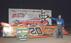 HARTFORD SPEEDWAY…Hometown He-ro Jr Hotovy goes to the win-ners circle in the final visit to Hartford Speedway by the American Ethanol Late Model Tour.