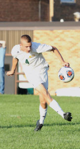 KICKIN' KOBE… Kobe Hunter kicks the ball downfield Wednesday during Coloma's game against Fennville. The Comets recorded their third win of the season by defeating the Blackhawks 3-1. Coloma is 3-0 this year. (TCR photo by Kristy Noack)