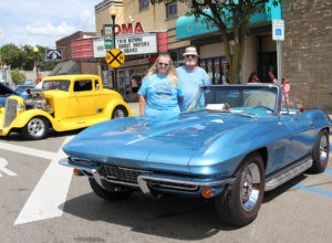 CAR SHOW…Jackie and Barney Hiler stand next to their 1967 Corvette after receiving the People's Choice Award in the Glad-Peach Car Show last Sunday morning. (TCR photo by Christina Gelder)