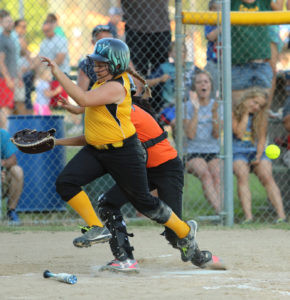 BARRELLING THROUGH… Addyson Milnickel doesn't let a Dowagiac catcher get in her way as she barrels across home plate during the team's outing in the Hartford All-Stars tour-nament on Tuesday, July 27. Milnickel scored on an in-the-park home run. (TCR photo by Kristy Noack)