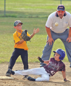 EYES ON IT…..Coloma second baseman Dylan McCoy keeps his eyes on the incoming ball as Watervliet's Marc Birmele keeps his on the bag. Birmele was safe. Watervliet would go on to win the 8U championship Tuesday, July 12 by defeating Coloma 21-6. (TCR photo by Kristy Noack)