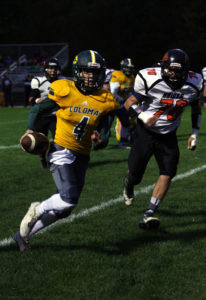 GOODLINE GOES FOR THE GOAL LINE… Coloma's varsi-ty football team notched their first win of the season Friday against Fennville 44-22. Coloma quarterback Zach Goodline scampers to the goal line for a touchdown in the first quarter. (TCR photo by Kristy Noack)