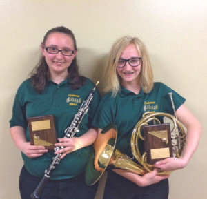 2016 COLOMA BAND DIRECTOR'S AWARDS… Morgan Gruss (pictured on the left) and Kimberly Spaulding (pictured on the right) were pre-sented with the 2016 Band Di-rector's Awards.  Morgan, the eighth grade award recipient, is the daughter of Monica Gruss and she plays oboe in the Co-loma Junior High Band.  Kim-berly, the seventh grade award recipient, is the daughter of Ja-son and Tracy Spaulding and she plays French horn in the Coloma Junior High Band. They were chosen by Mrs. Thomas for their dedication, leadership, and musicianship.