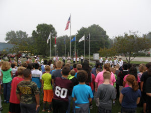 PATRIOT DAY REMEMBRANCE... lead by the Watervliet VFW and the North Berrien Military Rites Team, the heroes of the 9-11-01 terrorist attack and local first responders were saluted on Friday, September 9 at Veterans Park in downtown Watervliet. Also participating were more than 100 North School 5th graders who lead the crowd in the Pledge of Allegiance. Also participating in the service was singer Nancy Leeks, Pastor Ed Richcreek and City Commissioner Dan Hummel. The program was organized by the VFW with Commander Corky Openneer as MC. (TCR photo by Karl Bayer)