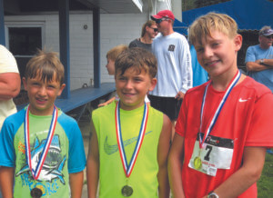 PPLYC BOYS' DIVISION WINNERS….Jackson Bain (left), Reed Kartes (center) and Leo Bowman finished third, second, and first, respectively, in the boys' division of Satur-day's triathlon. (Contributed photo)