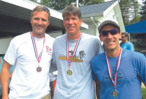 PAW PAW LAKE TRIATHLON MEN'S DIVISION WINNERS….In the men's division of Saturday's triathlon, Jeff Borah (left) won a third place medal, while David Gerst (center) captured the first place title, and Michael Moser (right) finished second. (Contributed photo)