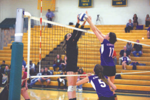COMET VS. COMET… Kelly Walter of Coloma (left) meets her Comet opponent from Ka-lamazoo Christian high above the net last Tuesday. Coloma lost the hard fought match 24-26, 25-22, 20-25, 29-27, 12-15. (TCR photo by Kristy Noack)