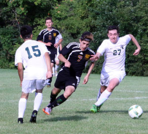 NICK OF TIME….Nick Pultz, a freshman on Hartford's varsi-ty soccer team, maneuvers past a South Haven player Wednes-day during the team's season opener. Hartford won the con-test 5-1. (TCR photo by Kristy Noack)