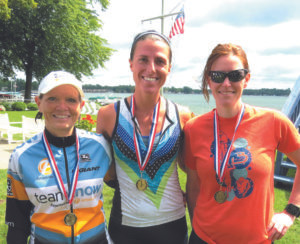 PAW PAW LAKE TRI WOMEN'S DIVISION WINNERS….Page Eisbrenner (center) finished first for the ladies in Saturday's triathlon. Tammy Shuler (left) took second place, while Caroline Walkinshaw (right) finished third. (Contributed photo)