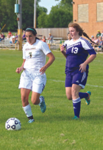 HICKS HITS IT… Coloma's Tristin Hicks heads toward the goal during Wednesday's game against Schoolcraft. Hicks would line up the ball, take the shot, and score! Hicks would rack up two goals and two as-sists during the 6-1 victory. (TCR photo by Kristy Noack)