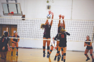 FOUR HANDS ARE BETTER THAN TWO… Watervliet's Kara Liles (7) and Zoe Smith (6, right) leap for the block during the Lady Panthers' match against Fennville last Tuesday. Liles had three blocks during the match, while Smith had one. Watervliet won 3-1. (TCR photo by Kristy Noack)
