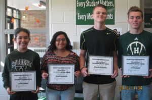 """HARTFORD HIGH SCHOOL'S """"STUDENTS OF THE WEEK""""… for October 31 – November 4 , are pictured (from the left): 9th Grade -Jessica Cardoso, daughter of Atilano & Erica Cardoso; 10th Grade -Abigail Rodriguez, daughter of Adam & Janie Ro-driguez; 11th Grade -Nicholas McGlothlin, son of Kenneth & Tamara McGlothlin; and 12th Grade - Austin Nelson, son of Troy Nelson & Kim Kostrzewa.  To become a Student of the Week, students are nominated by teachers or staff for doing something positive.  For exam-ple: getting a good grade on tests or homework, doing well in class participation or just be-ing a kind to another person.  Selected students will receive a certificate, their picture taken & posted in the HS front lobby showcase for the week and in the Tri-City Record newspaper.  At the end of the school year, all Students of the Week names will be entered in a drawing for some cool prizes, treats or gift cards. Congratulations to these Students of the Week and keep up the great work!"""