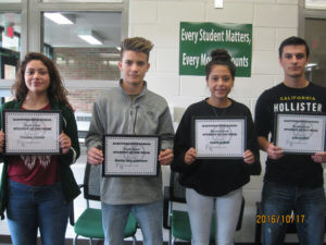 """HARTFORD HIGH SCHOOL'S """"STUDENTS OF THE WEEK""""… for October 10-14, are pictured (from the left): Yovana Naranjo (9th), daughter of Braulio Naranjo & Hortencia Victoria; Bradon Trey Acker-man (10th), son of Gary & Tammy Ackerman; Angela Sal-dana (11th), daughter of Bert & Marylou Saldana; and Jake Griffth (12th), son of Tony & Telisa Griffith. To become a Student of the Week, students are nominated by teachers or staff for doing something positive.  For exam-ple: getting a good grade on tests or homework, doing well in class participation or just be-ing a kind to another person.  Selected students will receive a certificate, their picture taken & posted in the HS front lobby showcase for the week and in the Tri-City Record newspaper.  At the end of the school year, all Students of the Week names will be entered in a drawing for some cool prizes, treats or gift cards. Congratulations to these Students of the Week and keep up the great work!"""