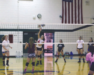 HARTFORD HITS 'EM!… Hartford volleyball players took to the net in preparation for their season opener tournament action against Lawton on Satur-day. (TCR photo by Kristy Noack)