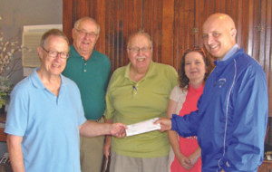 DONATION... Chris Phillips (right) representing Orchard Hill Landfill presents a $2,000 check to Rick Rasmussen (left) local organizer for the Paw Paw River clean up project. Looking on are project supporters, County Commissioner Bill Smith, Coloma Mayor Jim Polashak, and Coloma Watervliet Chamber Direcotr Chana Kniebes.