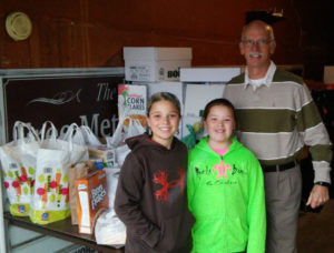 WATERVLIET NORTH SCHOOL STUDENTS… re-cently collected well over 600 food items for the Giving Liv-ing Water food pantry located at Watervliet Free Methodist Church. Pictured at the delivery are: (from the left) Grace Chisek, Jewell Burgess and Pastor Brian Hall. The students at North School hope that all families had a wonderful Thanksgiving holiday.