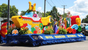BEST OVERALL FLOAT… Berrien Springs Yellow Subma-rine inspired float won the hearts of many as it visited Co-loma for the Glad-Peach Pa-rade, including the judges. They were the winners of the Best Overall Float. (TCR photo by Christina Geld-er)