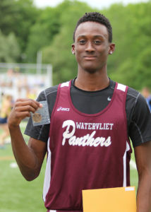 """LA IN THE SPOTLIGHT… Watervliet's Lamarrius Smith holds up his medal after win-ning third place in the long jump during Saturday's state finals. LA's leap was 20' 11"""".  (TCR photo by Kristy Noack)"""