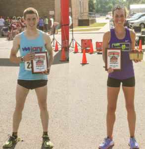 STRAWBERRY RUN WINNERS... Strawberry Run 1st Place finisher in the 5K Male Division was Nathan Blosser of Sodus, MI with a time of 18:02 (left) and 1st Place finisher in the 10K Female Division was Marron Brookes of Buchanan, MI with a time of 43:26.  (Doug Swift photo)