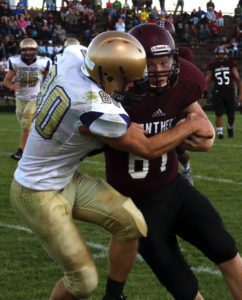 WIDE-EYED… Watervliet sophomore Matthew Melcher holds onto the ball while trying to push past Ben Crofoot of Schoolcraft Thursday night. Watervliet lost at home to the Eagles 51-30 and is now 1-1 on the season. (TCR photo by Kristy Noack)