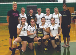 GOT GOLD!… The Coloma varsity volleyball squad earned a championship in their second outing of the 2016 season by topping Pennfield in Monday's Pennfield tournament by a score of 25-22, 25-16. Pictured are front row: (from the left) Kelly Walter, Nicolle Larson, Jenna Walter, and Kayla Yore. Back row: (from the left) Coach Kim Gear, Mika Anderson, Mya Pot-ter, Morgan Wagner, Hannah Mathis, Grace Hester, and Coach Gear.