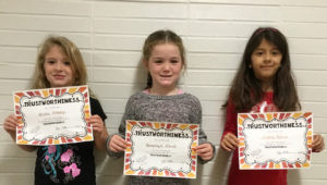 """WATERVLIET SOUTH SCHOOL CHARACTER AWARDS… At South Elemen-tary they are working on putting their South School pledge into action each day.  For November and December they are focusing on learning about and being trustworthy. The """"Trustworthi-ness"""" awards for Nov. 22, 2016 were presented to: (from the left) Alivia Stamp, kindergarten student in Mrs. Trapp's room; Brooklyn Smith, first grade stu-dent in Mrs. Cullitan's room; and Andrea Garcia, second grade student in Mrs. Iliff's room. Little Panthers… small but mighty!"""