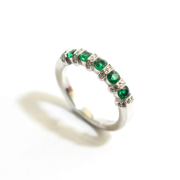 A platinum Columbian emerald and diamond scallop millgrain set half eternity ring. Total emerald weight 0.37ct, diamond weight 0.08ct, G colour, Vs1 clarity. £2,400.00