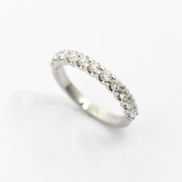 Platinum diamond set half eternity ring. The cog set brilliant cut diamonds totalling 0.68ct. £2,350.00