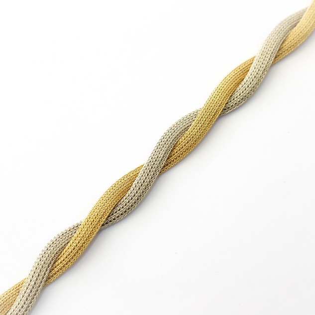 18ct yellow and white gold two tone woven link bracelet. Comprising of platted gold wire work. Italian, circa 1970s. £2,250.00 (with matching necklace)