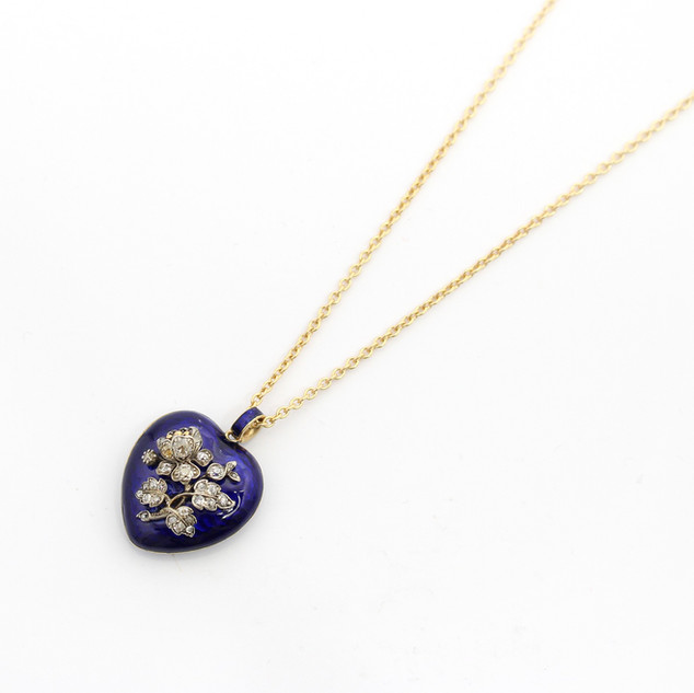 A fine Victorian 18ct gold heart shaped locket with central diamond set flower feature. The flower at centre of deep blue enamel. Completed with a enamelled pendant fitting and 18ct yellow gold trace link chain. Fine condition, circa 1870. £2,650.00