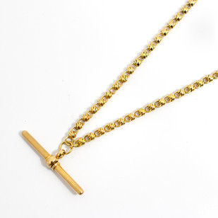 18ct double Albert watch chain with T bar, fancy cross over links. 18 inches long. 29.11 grams. £3,250.00