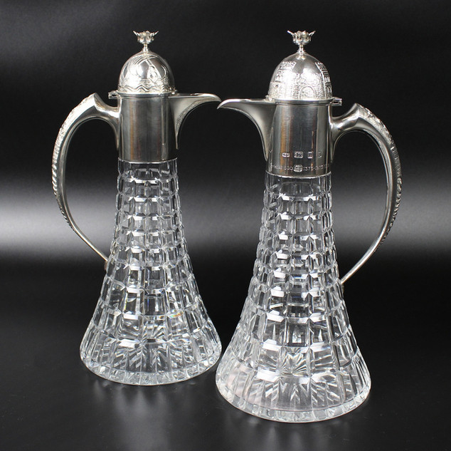 Anthony Elson 1973  Pair of claret jugs   £2000.00