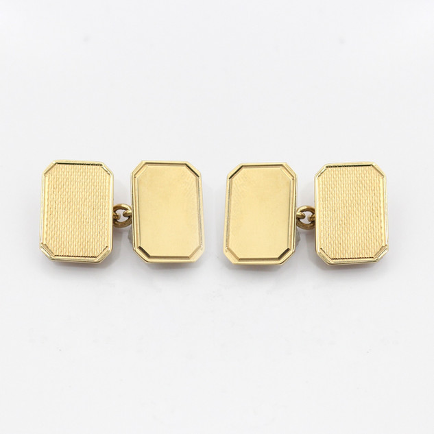 9ct yellow gold rectangular chain cufflinks with cut corners. One panel of each cufflink is engine turned. Birmingham 1990. By Deakin & Francis. £500.00