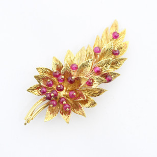 18ct yellow gold and ruby brooch in the form of a fern leave set with ruby beads secured by golden bead features. Most probably Italian. Circa 1970. £1,400.00