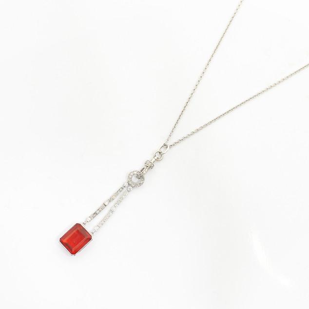 All platinum fire opal and diamond set pendant. The rectangular fire opal of bright orange colour, 4.10cts. C1920. £3,250.00