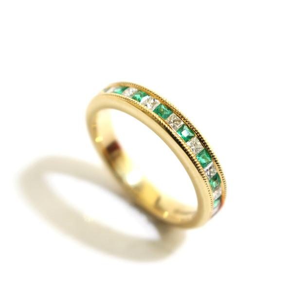 18ct yellow gold emerald, 0.26ct and diamond, 0.29ct, G colour, Vs1 millgrain set half eternity ring. £2,000.00